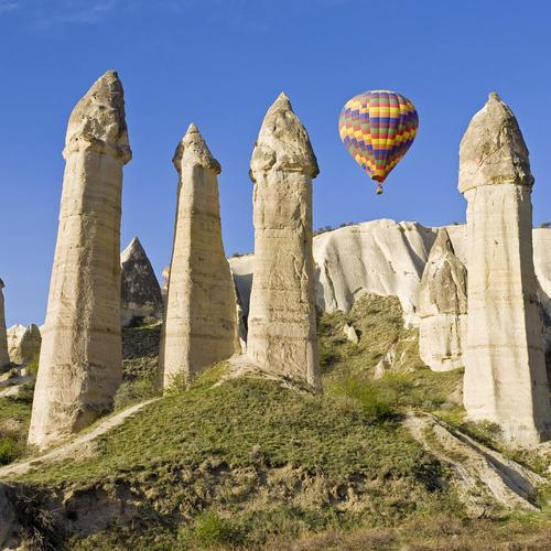 Air balloon parks on ancient monument
