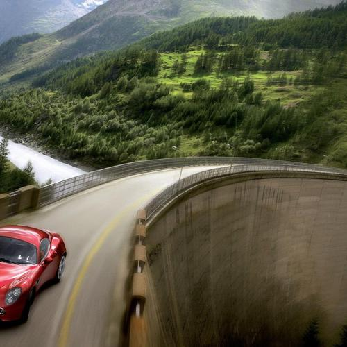 Alfa Romeo speeding over a dam wallpaper