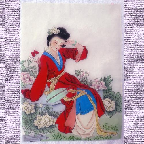 Asian girl in red kimono painting