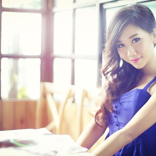 Asian long hair girl in purple dress