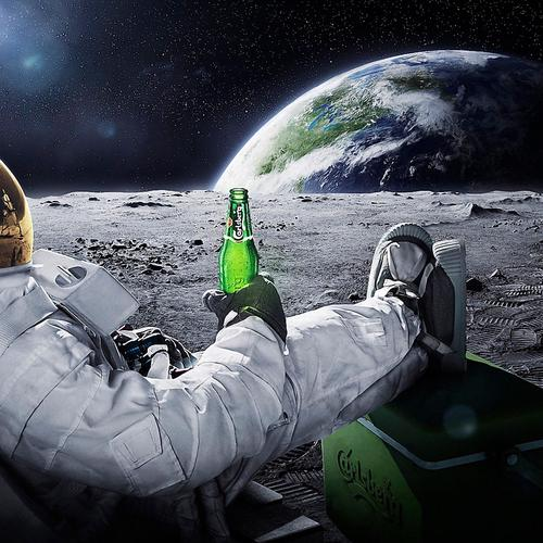 Astronaut chilling with beer on the moon