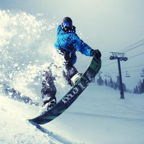 Awesome man snowboarding