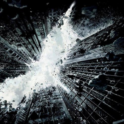 Batman the dark knight rises movie with city destruction wallpaper