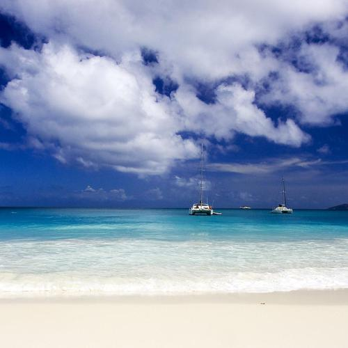 Beautiful blue beach with white sand wallpaper