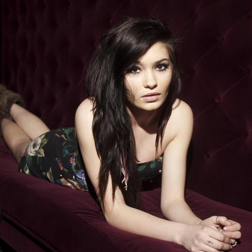 Beautiful Brunette Girl laying on sofa wallpaper
