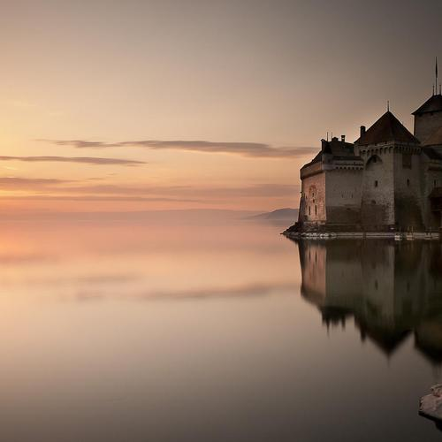 Beautiful castle on the lake at sunset