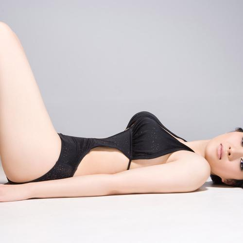 Beautiful chinese girl laying on the floor
