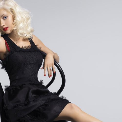 Beautiful Christina Aguilera sitting on the chair