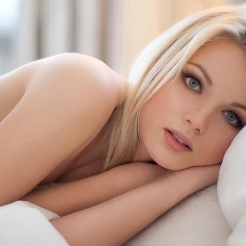 Beautiful girl sleeping on the bed with beautiful eyes