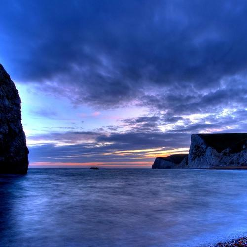 Beautiful rock arch in a cove at dusk