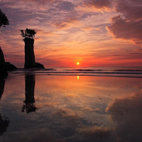 Beautiful sunset reflection on the beach
