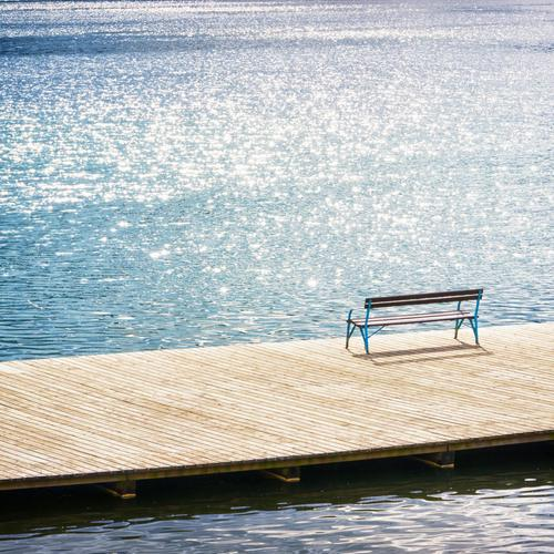 Bench on the dock in sunny day wallpaper