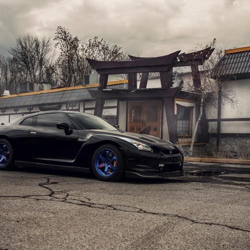 Black Nissan GT-R R35 with blue wheels wallpaper