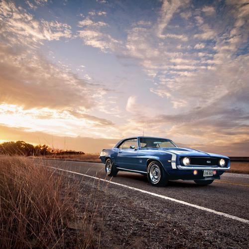 Blue classic car on the road wallpaper