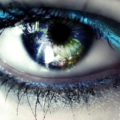Blue eye with Earth wallpaper