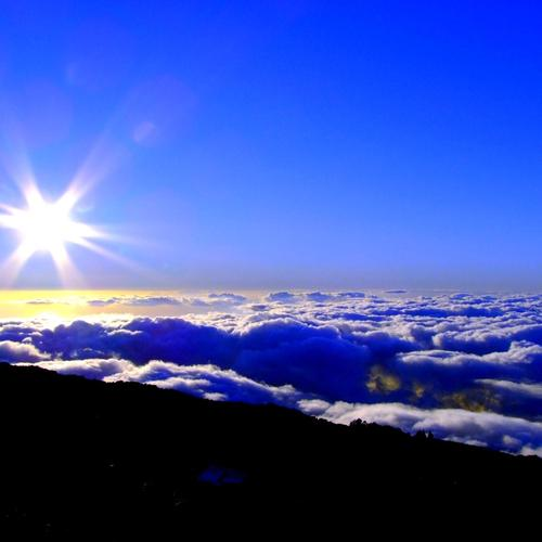 Blue sky with sun above the cloud