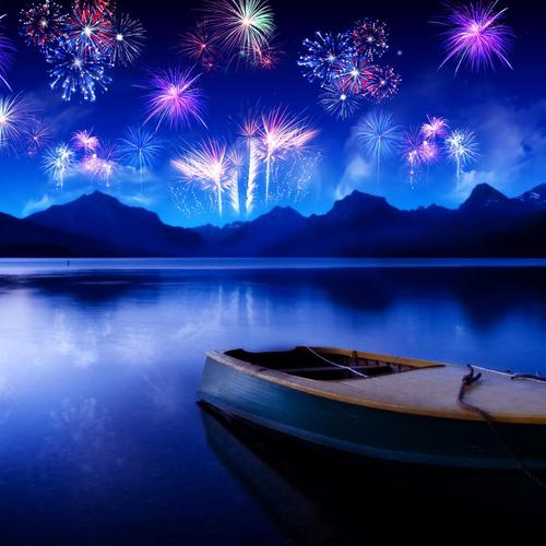 Boat on the lake with fireworks in night wallpaper