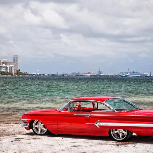 Bright red chevy on the beach wallpaper