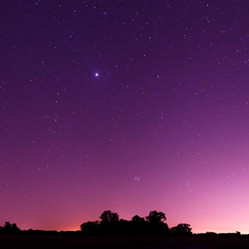 Bright star in a pink night sky
