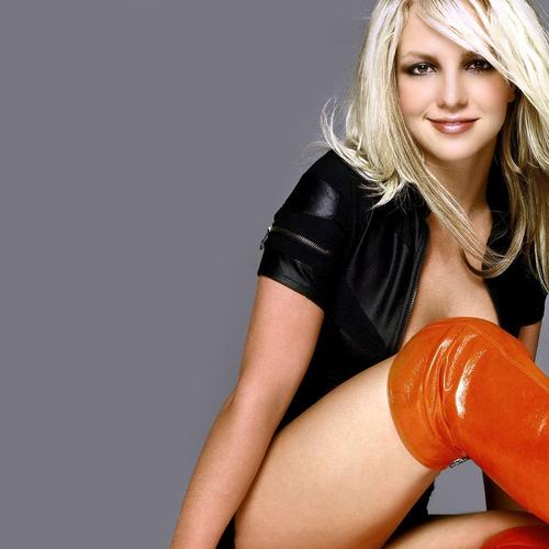 Britney Spears shows her long leg with orange boots wallpaper