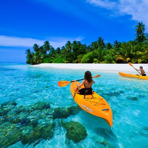 Canoe on blue lagoon in Maldives wallpaper