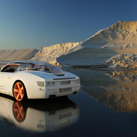 Car in reflection salt field wallpaper