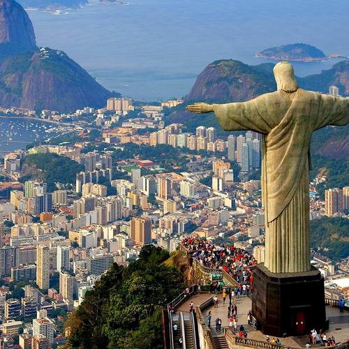 Christ The Redeemer statue looks down over Rio De Janeiro wallpaper