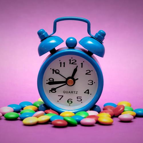 Clock and sweet candy