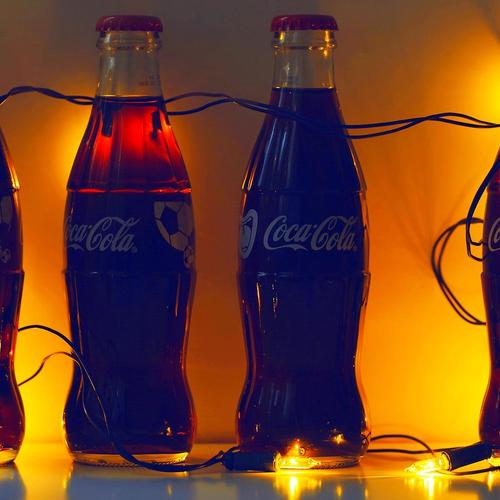 Coca cola glow with light bulbs