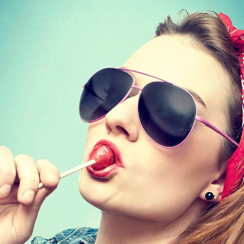 Cool girl wears sunglasses licking lolipop wallpaper