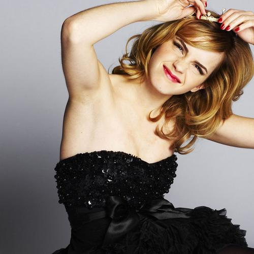 Cute Emma Watson in strapless gown dress wallpaper