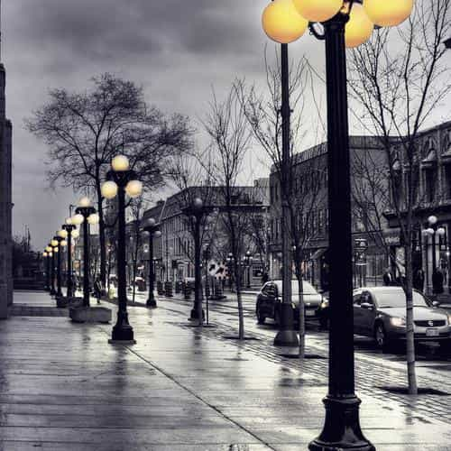 dark blue street with lamps