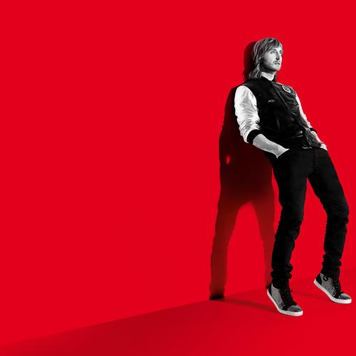 David Guetta in red background wallpaper