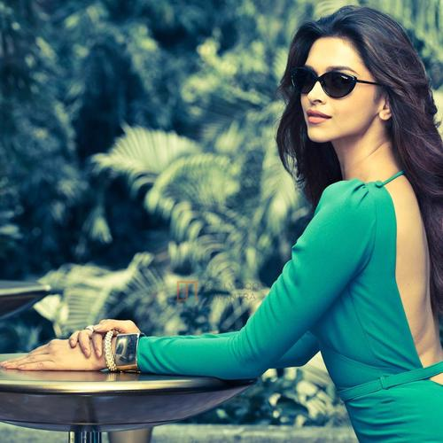 Deepika Padukone in green dress and sunglass wallpaper