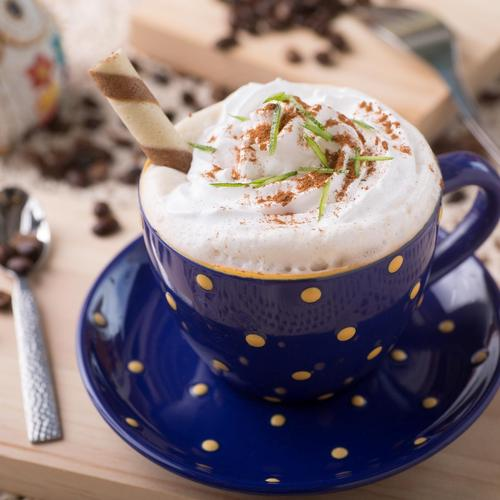 Delicious coffee cup with decorations
