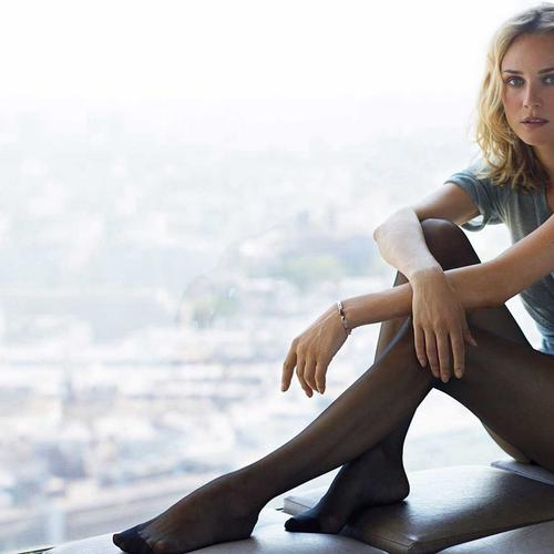 Diane Kruger sitting by window wallpaper
