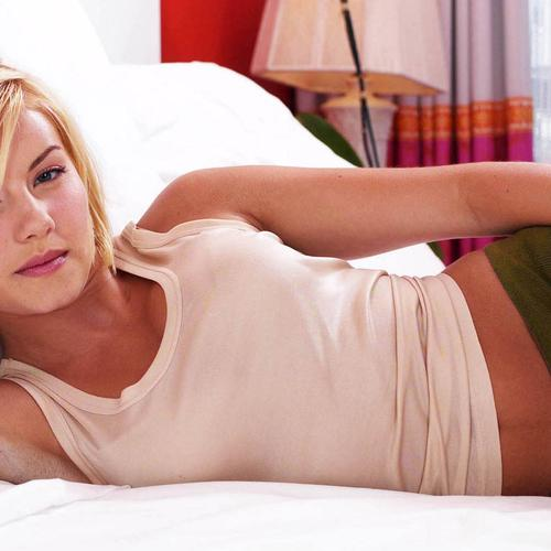 Elisha Cuthbert in white tank top laying on the bed
