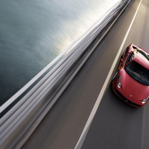 Ferrari 458 Italia running on the bridge wallpaper