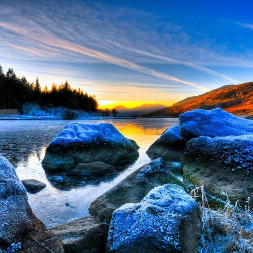 Frost rocks and river at sunrise