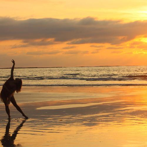 Girl dancing in sunset