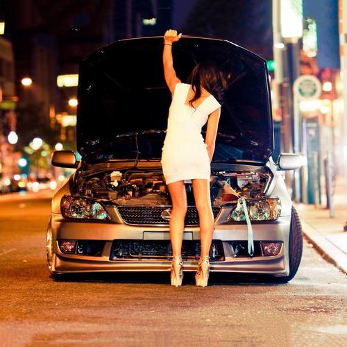 Girl in the white dress fixing car wallpaper