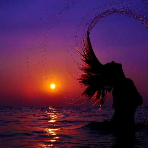 Girl shows her hair in sunset wallpaper