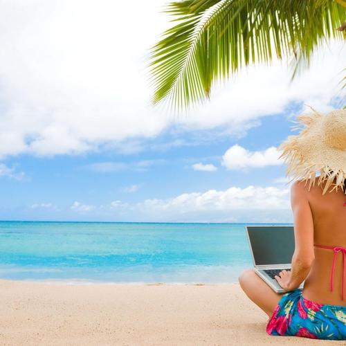Girl using laptop in tropical beach wallpaper