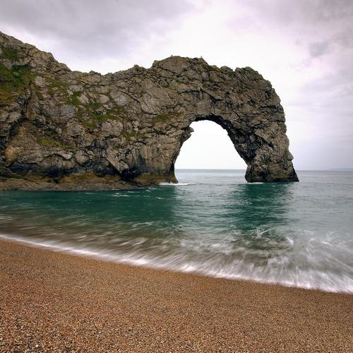 Glorious beach with arch rock wallpaper