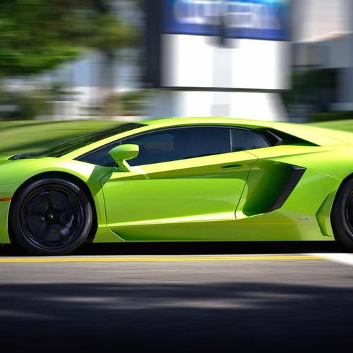 Green Lamborghini Aventador In Motion