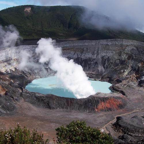 Hot lake in the center of a crater of a volcano