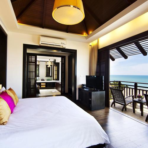 Hotel bedroom with seaview wallpaper