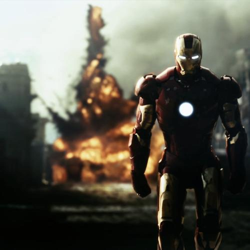 Iron man walking away from explosions