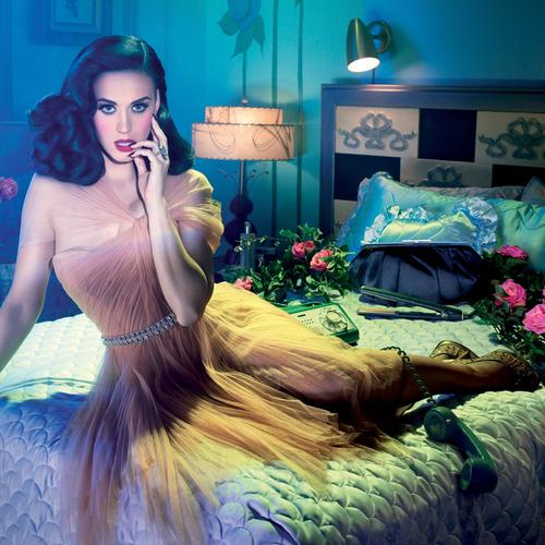 Katy Perry sitting on the bed with roses wallpaper