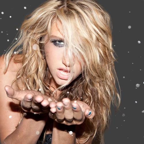 Kesha blowing gold dust from her hands